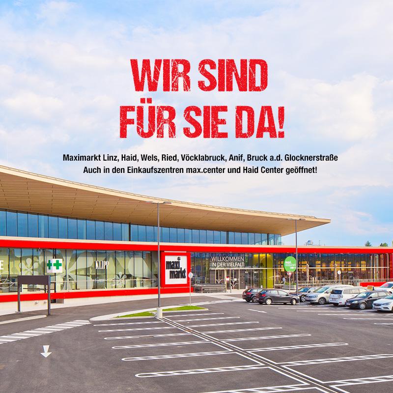 """Maximarkt Ried mit der Schrift """"Wir sind für Sie da""""."""